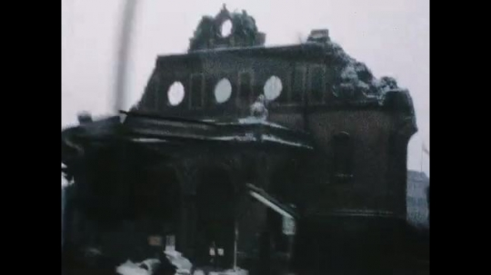UNITED STATES 1960s: View of damaged building from moving car / Tracking shot of crowd / Tracking shot of crowd / Tracking shot of crowd, car window.