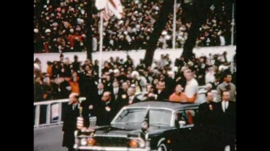 UNITED STATES 1960s: Richard Nixon and Patricia Nixon wave from car in parade / Car passes camera, zoom in on crowd / Car passes in parade.