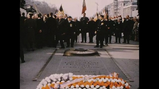 UNITED STATES 1960s: Men gathered at Tomb of the Unknown Soldier / Military band playing, zoom in on band.