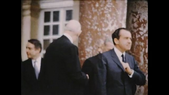 UNITED STATES 1960s: Richard Nixon outside Palace of Versailles with Charles de Gaulle / Nixon and de Gaulle standing / Nixon and de Gaulle turn, walk from camera.