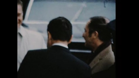 UNITED STATES 1960s: Richard Nixon talking with Pierre Trudeau and other, Nixon and men turn, walk up steps.