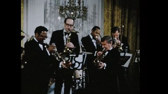UNITED STATES 1960s: Jazz band performing on stage / Band on stage, zoom out, zoom in, pan across band / Band on stage.