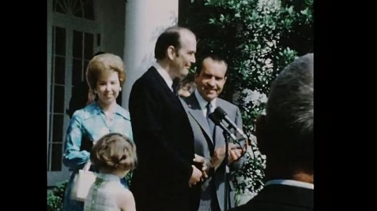 UNITED STATES 1960s: Robert Ellsworth with Richard Nixon, zoom in, Ellsworth speaks into microphone / Audience claps, pan to Ellsworth.