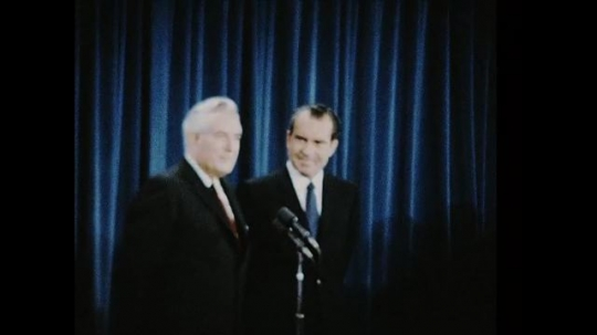UNITED STATES 1960s: Warren Burger with Richard Nixon on stage, zoom out, crowd applauds / Richard Nixon with Warren and Vera Burger / Nixon shakes hands with Burger
