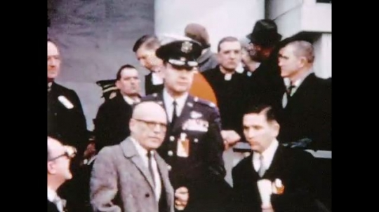 UNITED STATES 1960s: Men on steps at Nixon inauguration / Officer waves, men walk down steps, Richard Nixon and Gerald Ford pause on steps.