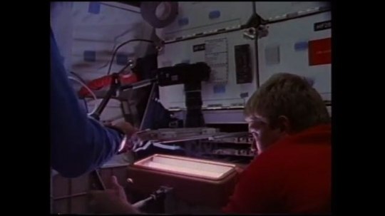 UNITED STATES: 1980s: astronauts grow protein crystals inside space shuttle. Scientific experiments in space.