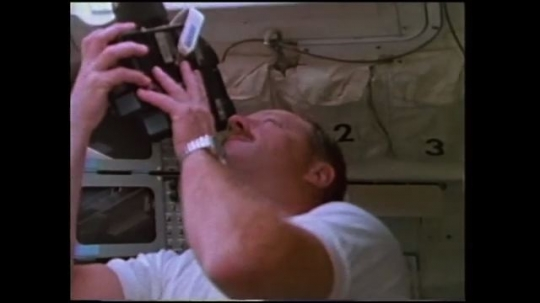 UNITED STATES: 1980s: astronaut observes earth from space through window