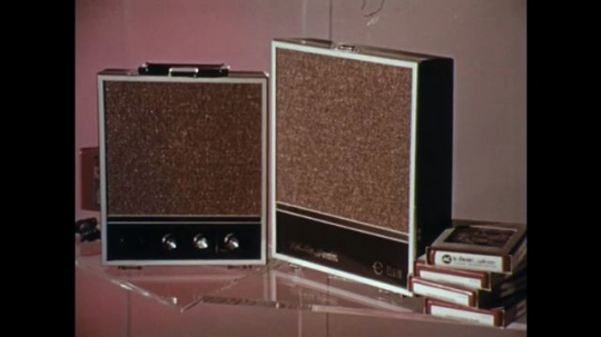 1970s: Radios / Man next to radios, talks into camera.