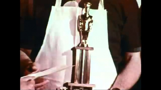 UNITED STATES: 1960s: chef presents meal to judges at table.