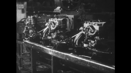 UNITED STATES: 1950s: engines on conveyor belts. Workers in Ford factory
