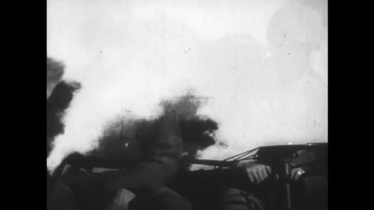 UNITED STATES: 1950s: war time explosions, gun fire, and soldiers