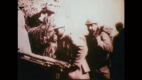 1910s: Military men carry supplies. Men run on battlefield. Plane drives on ground. Row of planes, plane takes off. Two men stand by plane. Pilot talks from cockpit. Two planes fly. Plane flies low.