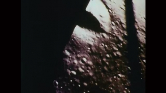 1969: Surface of moon approaches as spacecraft lands, closes in on spacecraft