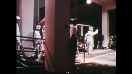 1960s: UNITED STATES: astronauts walk towards launch vehicle. Astronauts go up elevator to rocket. Surface of moon