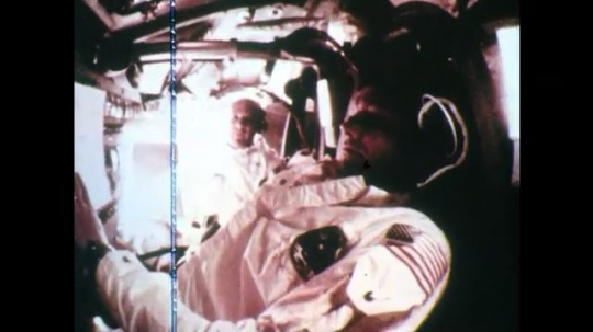 1960s: UNITED STATES: astronauts inside cabin. Astronaut shaves in space