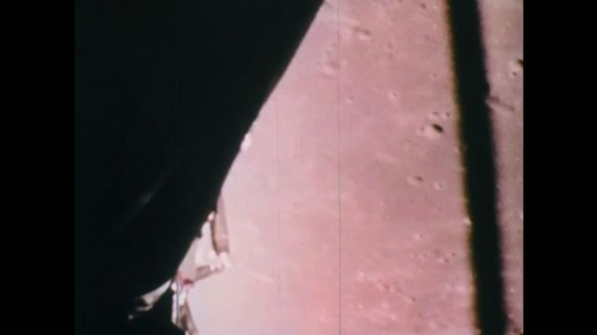 1960s: UNITED STATES: space capsule travels above surface of moon.