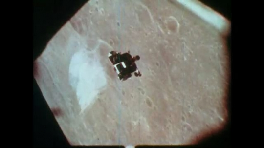 1970s lunar module orbits the moon and docks with command module.