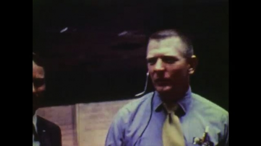 1970s: UNITED STATES: mission control scientists communicate during space flight