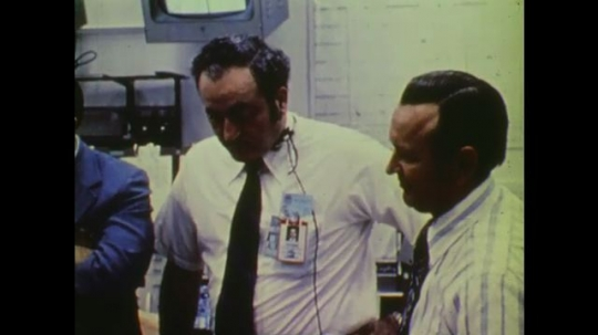 1970s: UNITED STATES: staff at mission control follow space flight