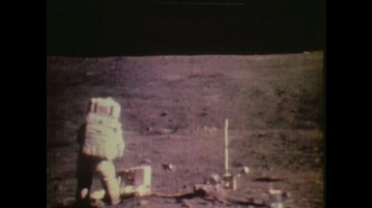 1970s: UNITED STATES: astronaut walks on moon.