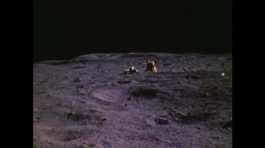 1970s: UNITED STATES: astronauts on moon buggy. Astronaut drives across moon