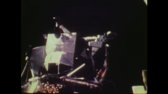 1970s: UNITED STATES: lunar lander on surface of moon. Astronaut collects samples.