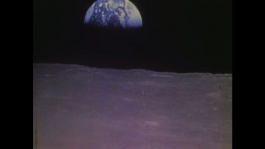 1970s: UNITED STATES: view of Earth from moon. Astronaut on space walk. Astronaut connects self to capsule