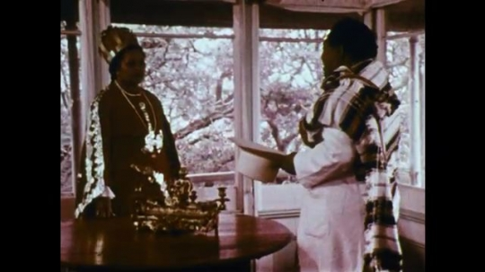 MADAGASCAR: 1970s: man speaks to Queen. Man listens in doorway.