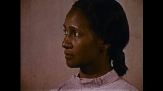MADAGASCAR: 1970s: man visits lady in house. Man picks up Bible.