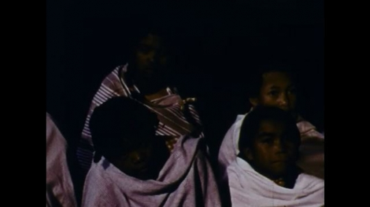 MADAGASCAR: 1970s: children listen to man speak at night. Christians gather in secret