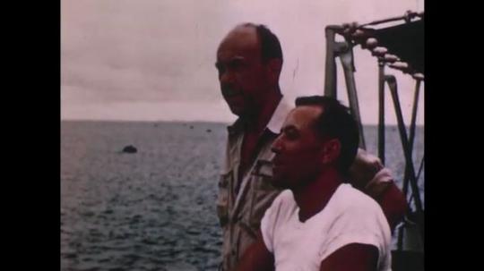 PACIFIC OCEAN: 1940s: men work on board research vessel. Ship at sea.