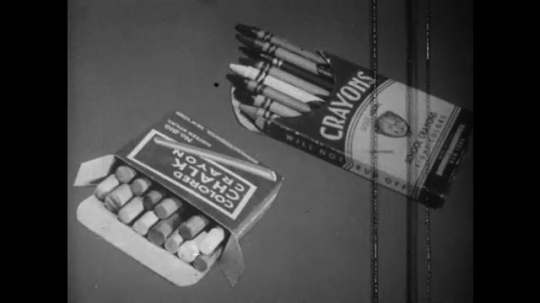 UNITED STATES: 1940s: pack of crayons and chalk on table. Tube of paint. Clay figures, Plasticine