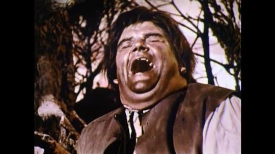 1960s: England: man laughs. Close up of man