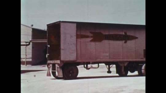 UNITED STATES: 1970s: lorry reverses to door. Forklift truck loads supplies into lorry.