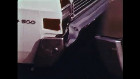 UNITED STATES: 1970s: cars collide. Drivers point at damage from crash.