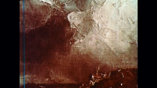 UNITED STATES: 1960s: close up of oil paint on landscape painting. Printing on paper. Fingers move paint across paper.