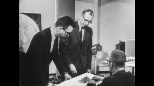 UNITED STATES: 1960s: man explains creation of panorama photo survey