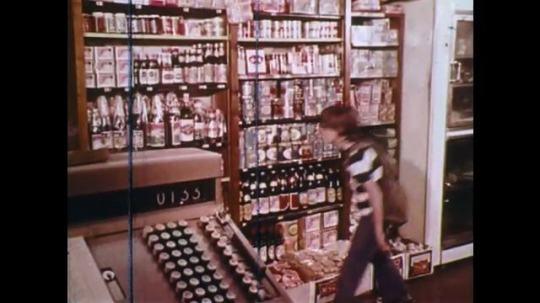 UNITED STATES: 1970s: children and man visit China Town Market shop. Oriental ingredients