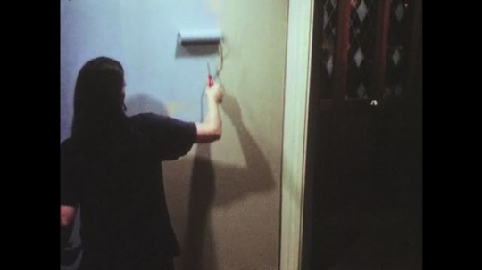 UNITED STATES: 1950s: person paints wall. Alcohol at party.