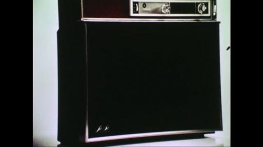 UNITED STATES: 1960s: hand turns on film on television set