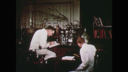 1950s: men work in chemisty laboratory. hand twists glassware and knobs on electronic device. men suck on pipettes. man and woman work in greenhouse.