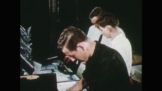 1950s: men roll ink onto metal plates in office. daily tarheel newspaper rolls off printing press. men at desks fidget with pens. man talks at podium. men write in classroom.