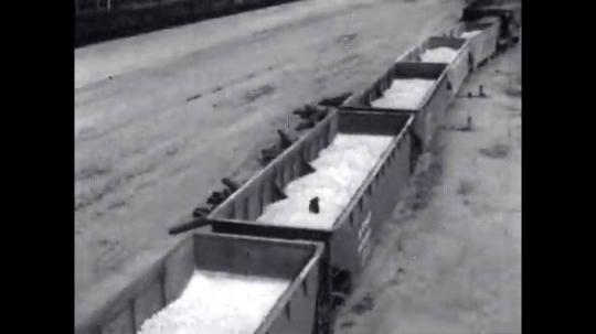 1950s: United States: limestone in railroad cars. Crushed limestone in cars.