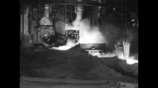 1950s: United States: mud gun seals hole in furnace.