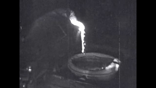 1950s: United States: molten iron poured into furnace. Liquid metal for production of steel