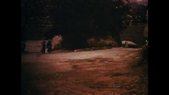 UNITED STATES: 1950s: men walk through clearing. Jesus walks by men.