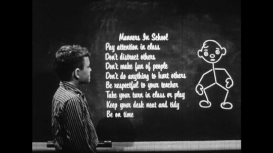 UNITED STATES: 1950s: Blackboard showing a list of rules for behaviour in school.