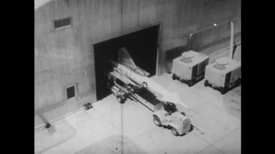 UNITED STATES: 1960S: overhead vie of missile. Logo on missile