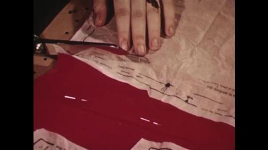 UNITED STATES: 1940s: scissors cut along cutting line on pattern.