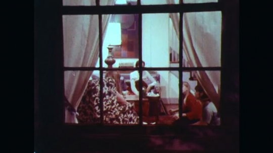 UNITED STATES: 1970s: teenagers arrive at house. Teenagers look through window